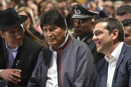 (AP Photo/Petros Giannakouris). Bolivian President Evo Morales, center, and Greece's Prime Minister Alexis Tsipras, right, take part in a conference in Athens, Thursday, March 14, 2019. Morales is in Greece on a two-day official visit.