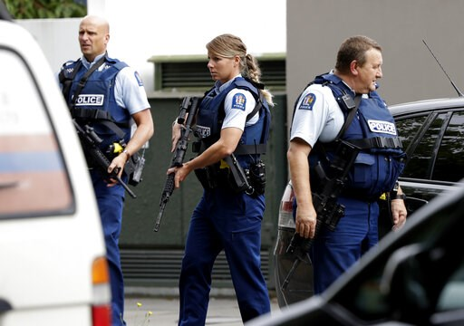 (AP Photo/Mark Baker). Armed police patrol outside a mosque in central Christchurch, New Zealand, Friday, March 15, 2019. A witness says many people have been killed in a mass shooting at a mosque in the New Zealand city of Christchurch.