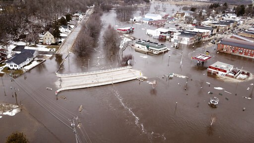 (Dave Kettering/Telegraph Herald via AP). The swollen Pecatonica River spills into downtown Darlington, Wis., on Thursday March 14, 2019. The National Weather Service has issued a flood warning or flood watch for about two-thirds of the state.