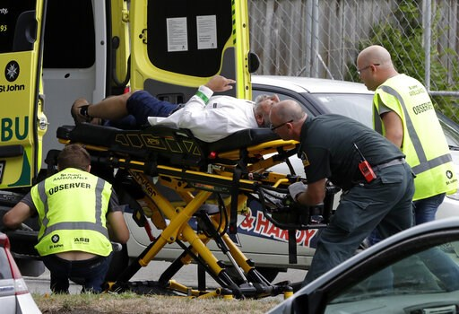 (AP Photo/Mark Baker). Ambulance staff take a man from outside a mosque in central Christchurch, New Zealand, Friday, March 15, 2019.  Multiple people were killed in mass shootings at two mosques full of worshippers attending Friday prayers on what the...