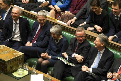 (UK Parliament/Mark Duffy via AP). In this handout photo provided by UK Parliament, Britain's Prime Minister Theresa May, centre, laughs during the Brexit debate in the House of Commons, London, Thursday March 14, 2019. Britain's Parliament has voted t...