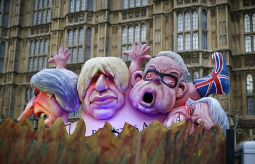 (AP Photo/Matt Dunham). Effigies of British politicians from left, Prime Minister Theresa May, Boris Johnson and Michael Gove are driven on a truck by anti-Brexit, remain in the European Union supporters outside the Houses of Parliament in London, Thur...