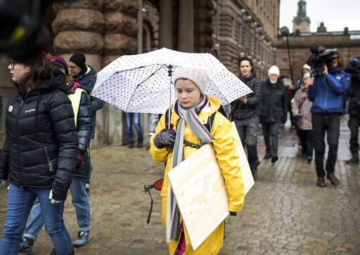 (Pontus Lundahl/TT News Agency via AP). Activist Greta Thunberg, foreground, participates in a climate protest, in central Stockholm Sweden, Friday, March 15, 2019. Students worldwide skipped classes Friday to take to the streets to protest their gover...