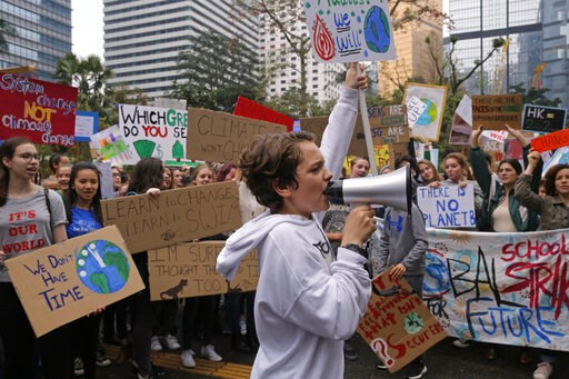 (AP Photo/Kin Cheung). Hundreds of schoolchildren take part in a climate protest in Hong Kong, Friday, March 15, 2019. Students in more than 80 countries and territories worldwide plan to skip class Friday in protest over their governments' failure to ...