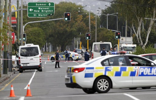 (AP Photo/Mark Baker). Police block the road near the shooting at a mosque in Linwood, Christchurch, New Zealand, Friday, March 15, 2019. Multiple people were killed during shootings at two mosques full of people attending Friday prayers.