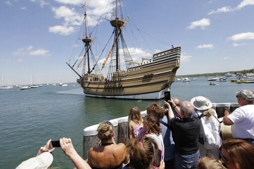 (AP Photo/Steven Senne, File). FILE - In this June 6, 2016 file photo, people on a wharf watch as the Mayflower II, the 1957 replica of the famed ship that carried the Pilgrims to Massachusetts in 1620, arrives in Plymouth Harbor in Plymouth, Mass. Org...