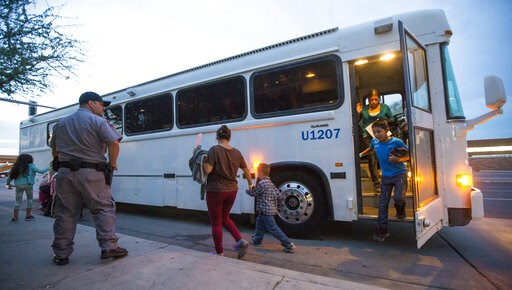 (Michael Chow/The Arizona Republic via AP, File). FILE - In this May 28, 2014 file photo, migrants are released from ICE custody at a Greyhound Bus station in Phoenix. Greyhound is no longer allowing immigration authorities to drop off families inside ...