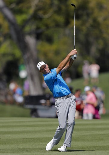 (AP Photo/Gerald Herbert). Jim Furyk hits his second shot off the 16th fairway during the second round of The Players Championship golf tournament Friday, March 15, 2019, in Ponte Vedra Beach, Fla.