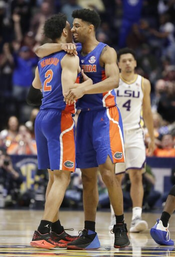 (AP Photo/Mark Humphrey). Florida guard Andrew Nembhard (2) is hugged by Jalen Hudson after Nembhard hit the winning 3-point basket against LSU in the second half of an NCAA college basketball game at the Southeastern Conference tournament Friday, Marc...