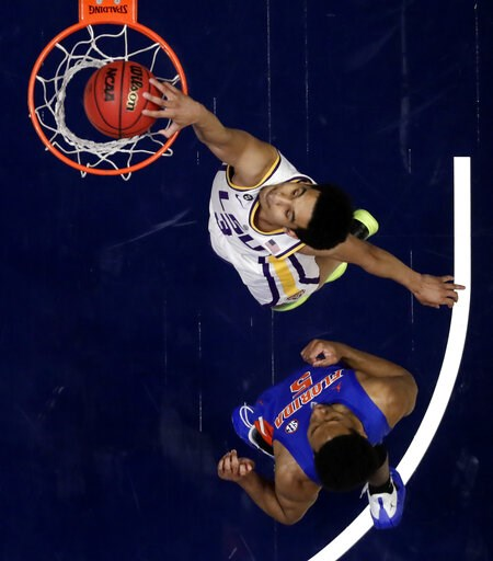 (AP Photo/Mark Humphrey). LSU guard Tremont Waters (3) dunks the ball ahead of Florida guard KeVaughn Allen (5) in the first half of an NCAA college basketball game at the Southeastern Conference tournament Friday, March 15, 2019, in Nashville, Tenn.