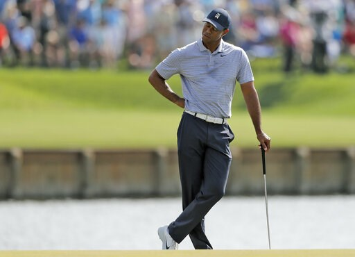 (AP Photo/Gerald Herbert). Tiger Woods reacts to hitting his drive into the water on the 17th hole during the second round of The Players Championship golf tournament Friday, March 15, 2019, in Ponte Vedra Beach, Fla.