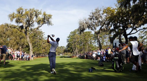 (AP Photo/Gerald Herbert). Tiger Woods hits his drive on the 15th hole during the second round of The Players Championship golf tournament Friday, March 15, 2019, in Ponte Vedra Beach, Fla.
