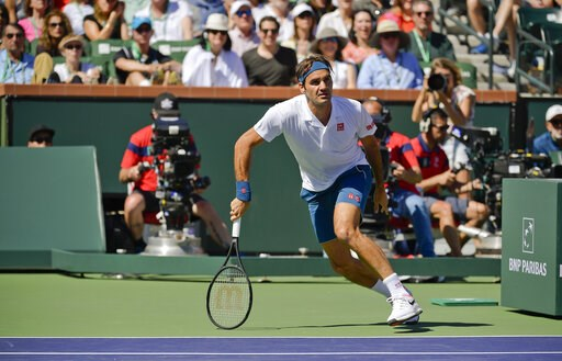 (AP Photo/Mark J. Terrill). Roger Federer, of Switzerland, chases a ball against Hubert Hurkacz, of Poland at the BNP Paribas Open tennis tournament Friday, March 15, 2019, in Indian Wells, Calif.