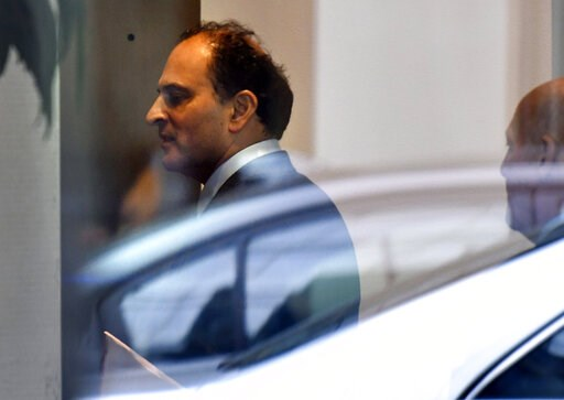 (AP Photo/Josh Reynolds). David Sidoo, of Vancouver, Canada, enters an adjacent building with his lawyer following a federal court hearing Friday, March 15, 2019, in Boston. Sidoo faced charges of conspiracy to commit mail and wire fraud as part of a w...