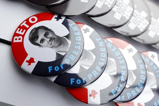(AP Photo/Charlie Neibergall). Buttons for former Texas congressman Beto O'Rourke sit on display during a stop at the Central Park Coffee Company, Friday, March 15, 2019, in Mount Pleasant, Iowa. O'Rourke announced Thursday that he'll seek the 2020 Dem...