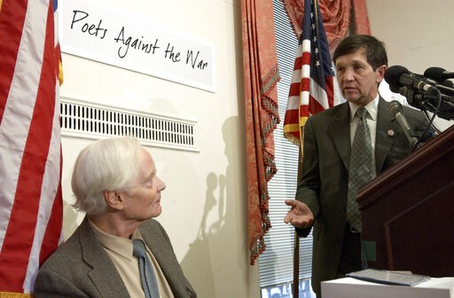 (AP Photo/Evan Vucci, File). FILE -- In this March 5, 2003 file photo, U.S. Rep. Dennis Kucinich, D-Ohio, right, gestures toward Pulitzer Prize winning poet W.S. Merwin during a Capitol Hill news conference. Merwin, a prolific and versatile master of m...