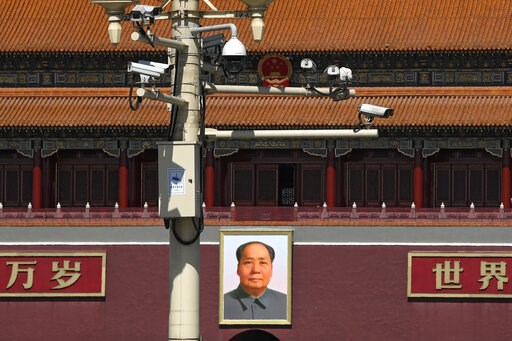 (AP Photo/Andy Wong). Surveillance cameras are mounted on a lamp post near the large portrait of Chinese leader Mao Zedong at the Tiananmen Gate in Beijing, Friday, March 15, 2019. Chinese Premier Li Keqiang on Friday denied Beijing tells its companies...