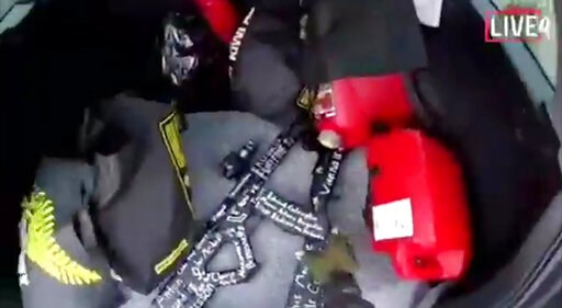 (Shooter's Video via AP). In this frame from video that was livestreamed Friday, March 15, 2019, a gunman who used the name Brenton Tarrant on social media reaches for a gun in the back of his car before the mosque shootings in Christchurch, New Zealand.