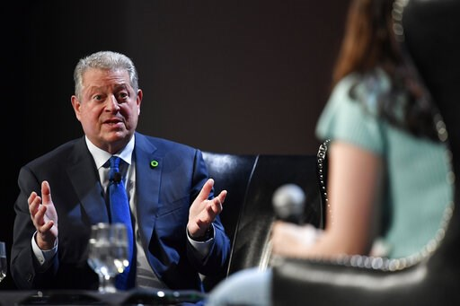 (AP Photo/Mike Stewart). Former U.S. Vice President Al Gore, founder of the Climate Reality Project, speaks with youth climate activists durung a panel discussion on global climate, Friday, March 15, 2019, in Atlanta.