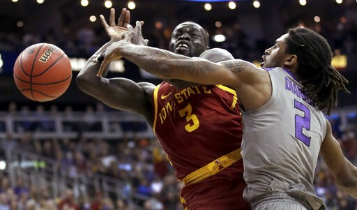 (AP Photo/Charlie Riedel). Kansas State's Cartier Diarra (2) knocks the ball away from Iowa State's Marial Shayok (3) during the first half of an NCAA college basketball game in the Big 12 men's tournament Friday, March 15, 2019, in Kansas City, Mo.