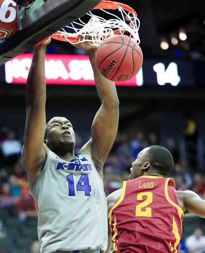 (AP Photo/Orlin Wagner). Kansas State forward Makol Mawien (14) dunks over Iowa State forward Cameron Lard (2) during the first half of an NCAA college basketball game in the semifinals of the Big 12 Conference tournament in Kansas City, Mo., Friday, M...