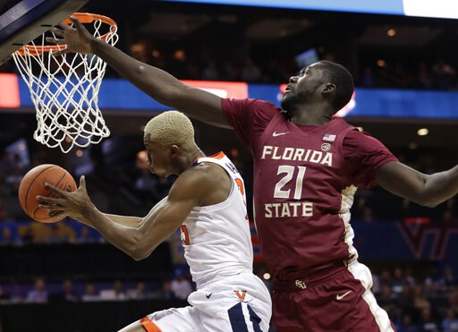 (AP Photo/Chuck Burton). Virginia's Mamadi Diakite, left, drives past Florida State's Christ Koumadje, right, during the first half of an NCAA college basketball game in the Atlantic Coast Conference tournament in Charlotte, N.C., Friday, March 15, 2019.