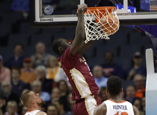 (AP Photo/Chuck Burton). Florida State's Christ Koumadje (21) dunks against Virginia during the first half of an NCAA college basketball game in the Atlantic Coast Conference tournament in Charlotte, N.C., Friday, March 15, 2019.
