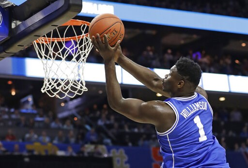 (AP Photo/Chuck Burton). Duke's Zion Williamson (1) drives to the basket against North Carolina during the first half of an NCAA college basketball game in the Atlantic Coast Conference tournament in Charlotte, N.C., Friday, March 15, 2019.