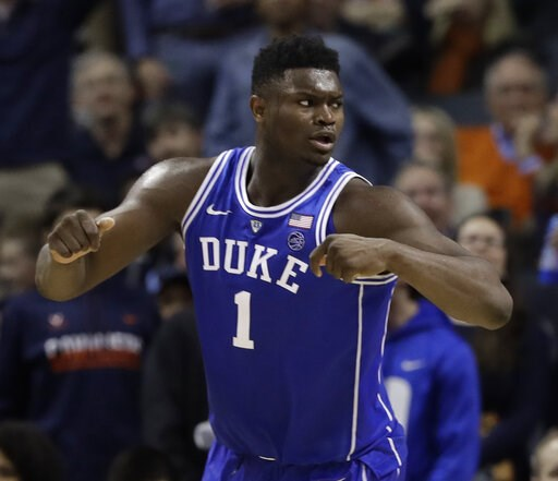 (AP Photo/Chuck Burton). Duke's Zion Williamson (1) reacts after scoring against North Carolina during the second half of an NCAA college basketball game in the Atlantic Coast Conference tournament in Charlotte, N.C., Friday, March 15, 2019.