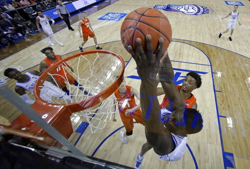 (AP Photo/Chuck Burton). Duke's Zion Williamson, right, dunks against Syracuse during the second half of an NCAA college basketball game in the Atlantic Coast Conference tournament in Charlotte, N.C., Friday, March 15, 2019.