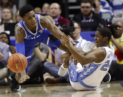 (AP Photo/Chuck Burton). Duke's RJ Barrett, left, and North Carolina's Kenny Williams, right, chase a loose ball during the second half of an NCAA college basketball game in the Atlantic Coast Conference tournament in Charlotte, N.C., Friday, March 15,...