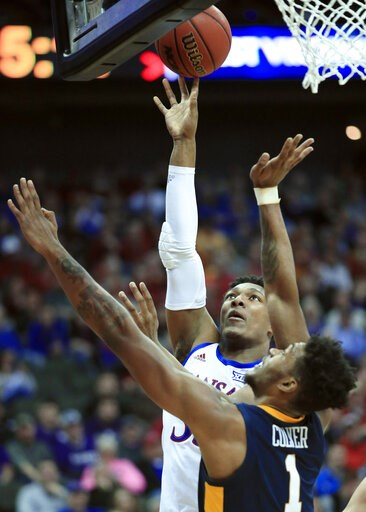 (AP Photo/Orlin Wagner). Kansas forward David McCormack (33) shoots over West Virginia forward Derek Culver (1) during the first half of an NCAA college basketball game in the semifinals of the Big 12 conference tournament in Kansas City, Mo., Friday, ...