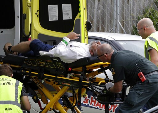 (AP Photo/Mark Baker). Ambulance staff take a man from outside a mosque in central Christchurch, New Zealand, Friday, March 15, 2019, following a mass shooting.