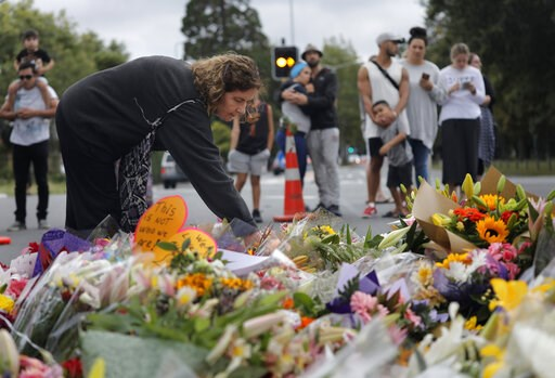 (AP Photo/Vincent Yu). Mourners paying their respects at a makeshift memorial near the Masjid Al Noor mosque, Saturday, March 16, 2019, Christchurch, New Zealand, where one of the two mass shootings occurred. The white supremacist gunman appeared in co...