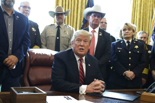 (AP Photo/Evan Vucci). In this March 15, 2019, photo, President Donald Trump speaks about border security in the Oval Office of the White House, Friday, March 15, 2019, in Washington. Trump's veto of a bipartisan congressional resolution rejecting his ...