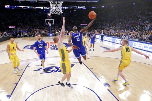 (AP Photo/Julio Cortez). Seton Hall guard Quincy McKnight (0) goes up for a shot against Marquette forward Joey Hauser (22) during the first half of an NCAA college basketball semifinal game in the Big East men's tournament, Friday, March 15, 2019, in ...