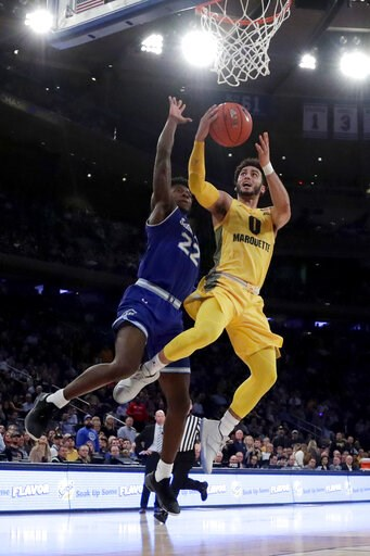 (AP Photo/Julio Cortez). Marquette guard Markus Howard (0) goes up for a shot against Seton Hall guard Myles Cale (22) during the first half of an NCAA college basketball semifinal game in the Big East men's tournament, Friday, March 15, 2019, in New Y...