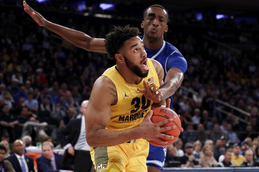(AP Photo/Julio Cortez). Marquette forward Ed Morrow (30) drives against Seton Hall center Romaro Gill (35) during the first half of an NCAA college basketball semifinal game in the Big East men's tournament, Friday, March 15, 2019, in New York.