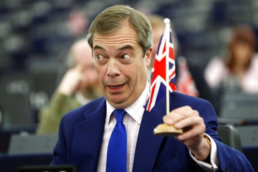 (AP Photo/Jean Francois Badias). Former U.K. Independence Party (UKIP) leader and member of the European Parliament Nigel Farage holds a U.K. flag during a plenary session at the European Parliament in Strasbourg, eastern France, Wednesday, March 13, 2...