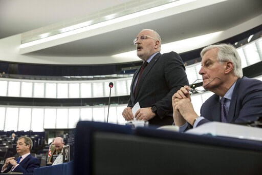 (AP Photo/Jean Francois Badias). European Union's Frans Timmermans, first vice president of the Commission, center, delivers his speech with European Union's chief Brexit negotiator Michel Barnier, at right, and Former U.K. Independence Party (UKIP) le...