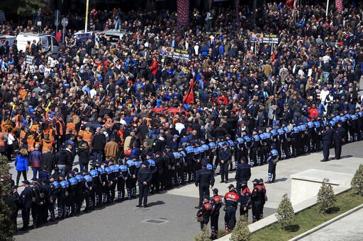 (AP Photo/ Hektor Pustina). Protesters gather outside the Prime Minister's office during an anti-government rally in Tirana, Albania, Saturday, March 16, 2019. Thousands of supporters of the center-right Democratic Party-led opposition have gathered on...