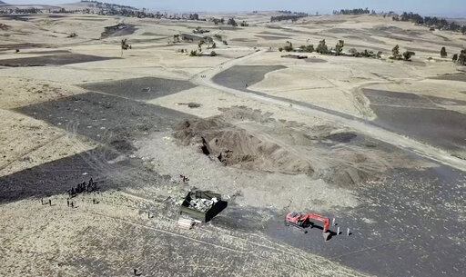 (AP Photo/Yidnek Kirubel). This aerial image made from video shows recovery work continuing at the scene where the Ethiopian Airlines Boeing 737 Max 8 crashed shortly after takeoff on Sunday killing all 157 on board, near Bishoftu, south-east of Addis ...