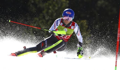 (AP Photo/Alessandro Trovati). United States' Mikaela Shiffrin speeds down the course during an alpine ski, women's slalom, at the alpine ski, World Cup finals in Soldeu, Andorra, Saturday, March 16, 2019.