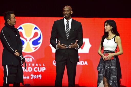 (Chinatopix via AP). Former NBA basketball player and FIBA World Cup Ambassador Kobe Bryant, center, speaks during the draw ceremony for the 2019 FIBA Basketball World Cup in Shenzhen in southern China's Guangdong Province, Saturday, March 16, 2019. Th...