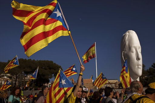 """(AP Photo/Emilio Morenatti). Catalan pro-independence demonstrators hold """"estelada,"""" or separatist flags, as they arrive to Madrid, Spain, Saturday, March 16, 2019. Demonstrators made their way to Spain's capital to show support for former regional pol..."""
