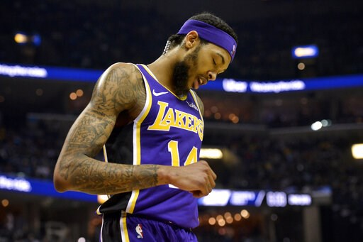 (AP Photo/Brandon Dill, File). FILE - In this Monday, Feb. 25, 2019, file photo, Los Angeles Lakers forward Brandon Ingram (14) plays in the first half of an NBA basketball game against the Memphis Grizzlies in Memphis, Tenn. Ingram will miss the rest ...