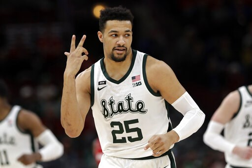 (AP Photo/Nam Y. Huh). Michigan State's Kenny Goins (25) reacts after shooting a 3-point basket during the first half of an NCAA college basketball game against Wisconsin in the semifinals of the Big Ten Conference tournament, Saturday, March 16, 2019,...