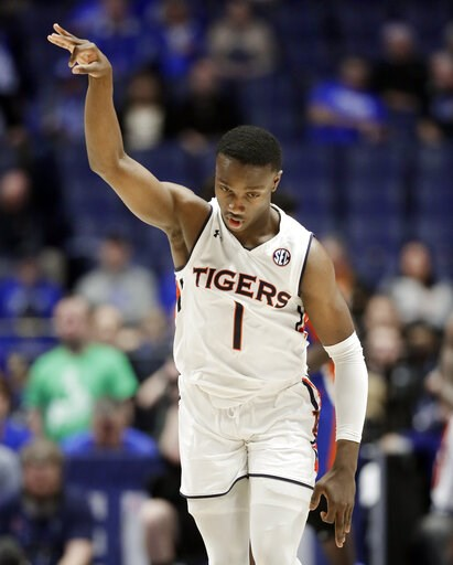 (AP Photo/Mark Humphrey). Auburn guard Jared Harper celebrates after making a 3-point basket against Florida in the first half of an NCAA college basketball game at the Southeastern Conference tournament Saturday, March 16, 2019, in Nashville, Tenn.