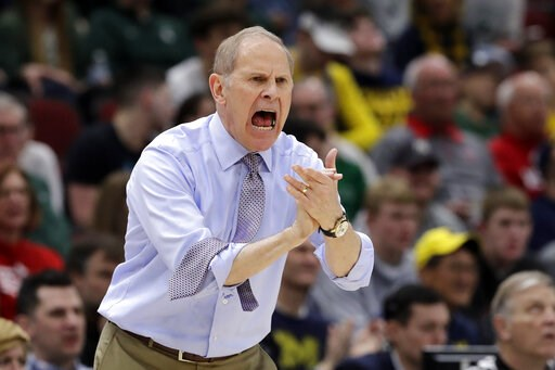 (AP Photo/Nam Y. Huh). Michigan head coach John Beilein directs his team during the first half of an NCAA college basketball game against Minnesota in the semifinals of the Big Ten Conference tournament, Saturday, March 16, 2019, in Chicago.