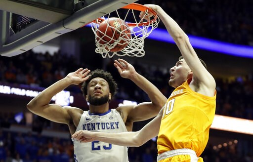 (AP Photo/Mark Humphrey). Tennessee forward John Fulkerson (10) dunks against Kentucky forward EJ Montgomery (23) in the first half of an NCAA college basketball game at the Southeastern Conference tournament Saturday, March 16, 2019, in Nashville, Tenn.